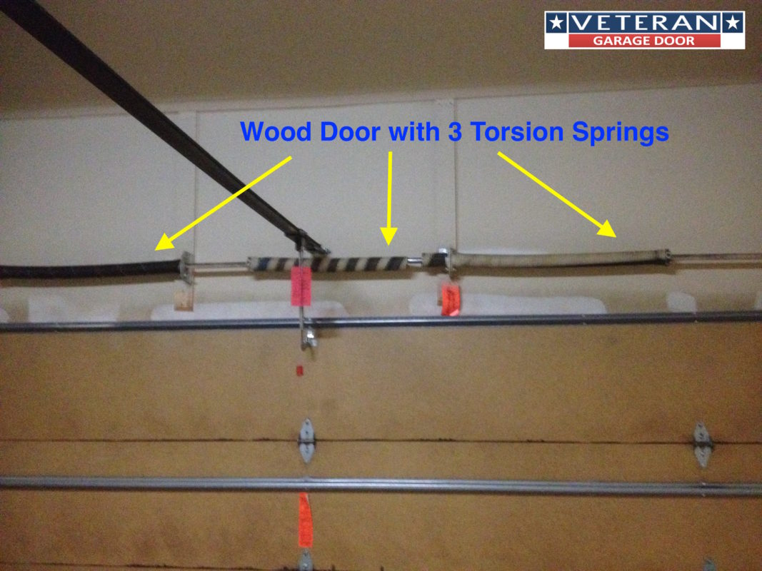 Three torsion spring wood door for How much to replace a garage door torsion spring
