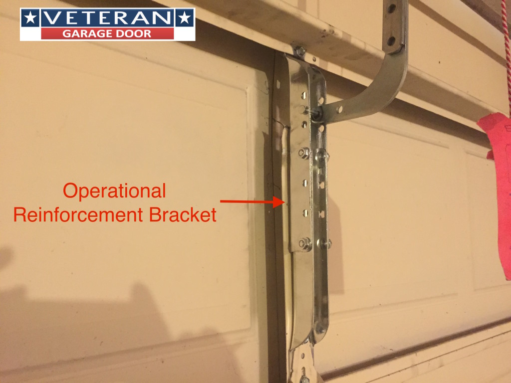 garage door reinforcement bracketMetal piece broke on garage door section can I fix it