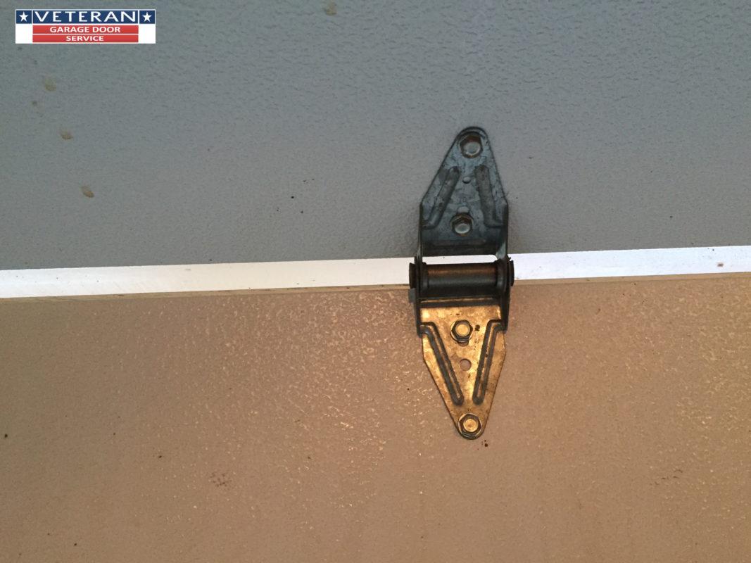Can A Broken Garage Door Hinge Damage The Garage Door