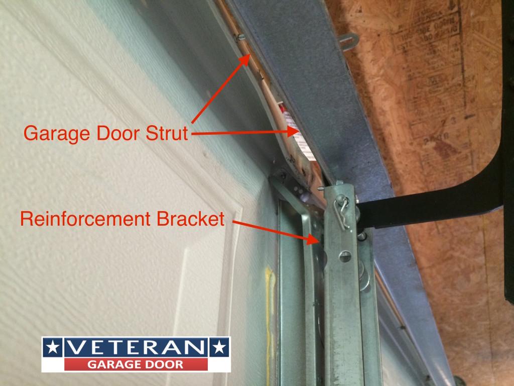 Metal Piece Broke On Garage Door Section Can I Fix It
