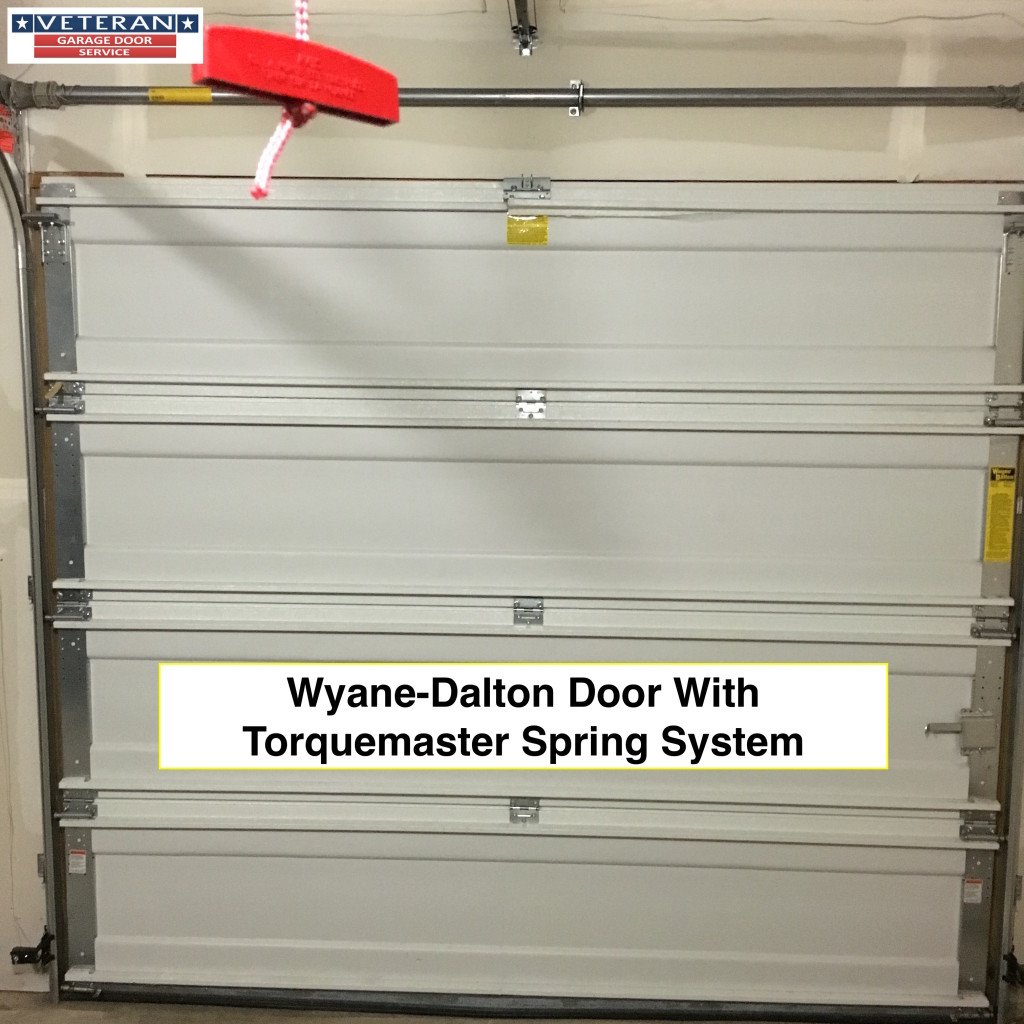 Should i get a torsion spring system or torquemaster springs system - Wayne dalton garage door panels ...