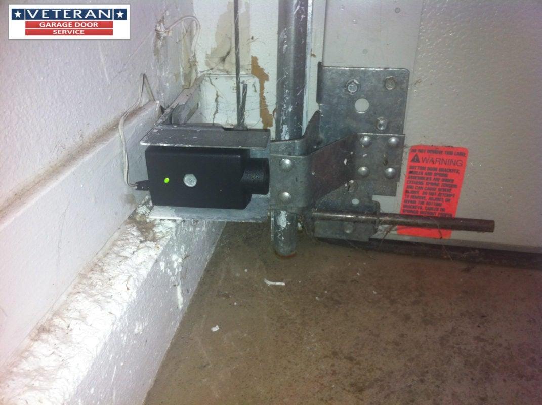 How high should garage door safety eyes be mounted for Fix garage door sensor