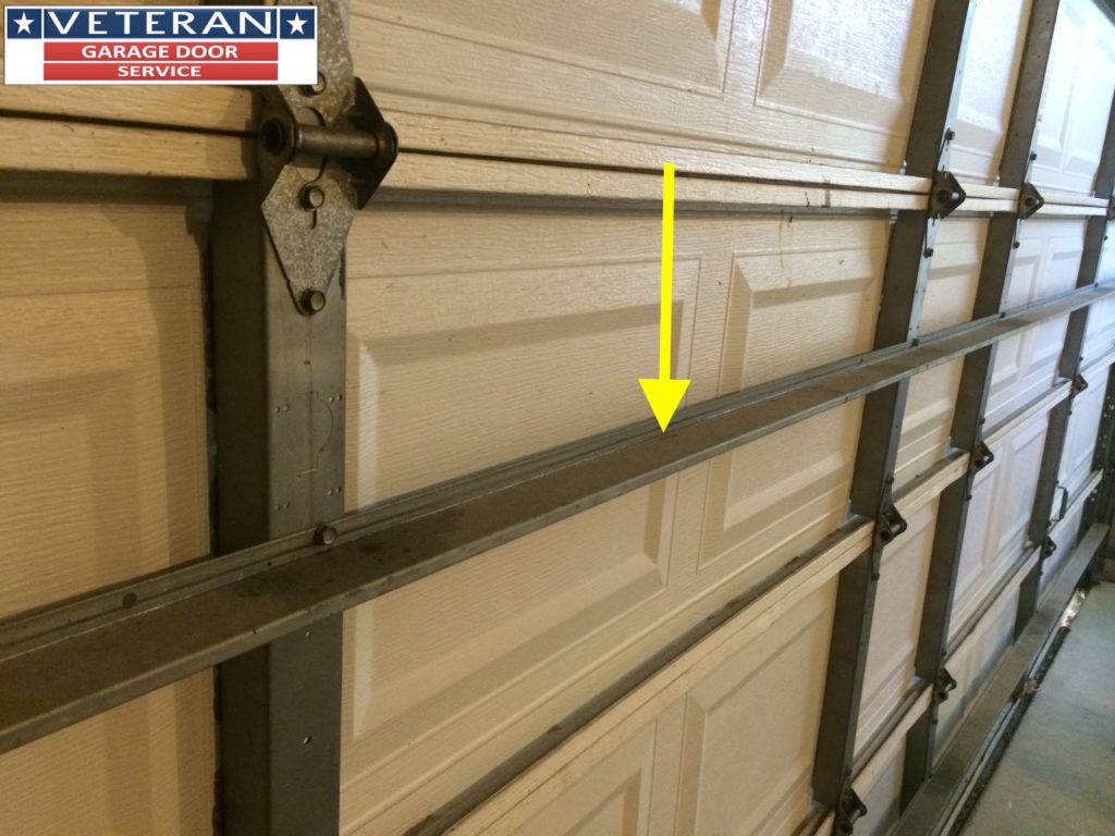 Should i install a strut or replace my garage door section for Garage doors plano