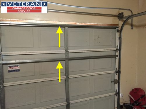 Should I install a strut or replace my garage door section